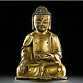 A gilt-bronze figure of a seated shakyamuni buddha, ming dynasty, 16th century