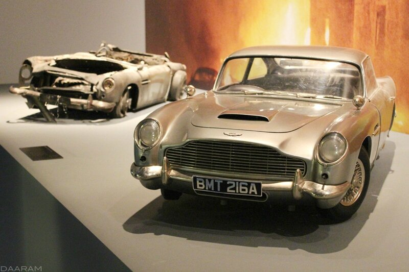 Two scale models (destroyed or not) of the famous Aston Martin DB5. « Skyfall » 2012. Photo: Olivier Daaram Jollant © 2016